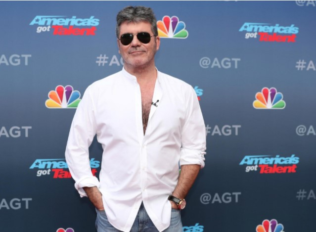 Simon Cowell - 5 feet 8 inches