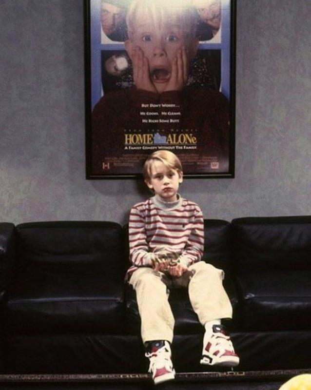 Macaulay Culkin With A Home Alone Poster